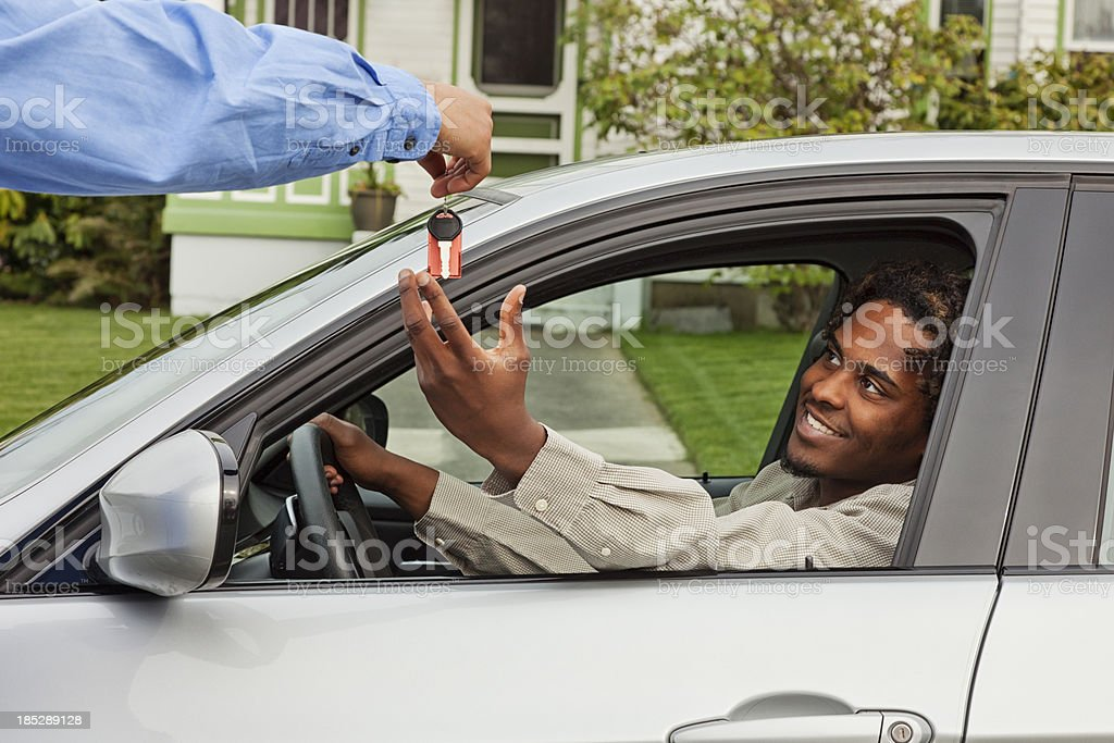 Young Man Borrowing Friend's Car stock photo