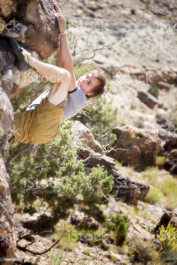 Young Man Bouldering royalty-free stock photo