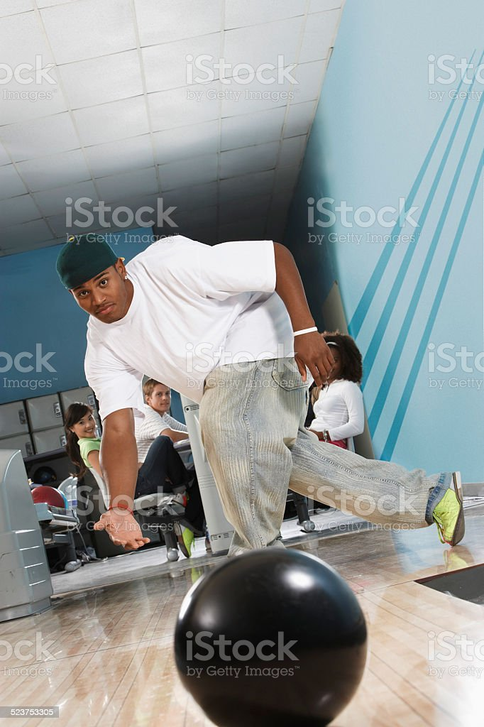 Young Man Bowling stock photo