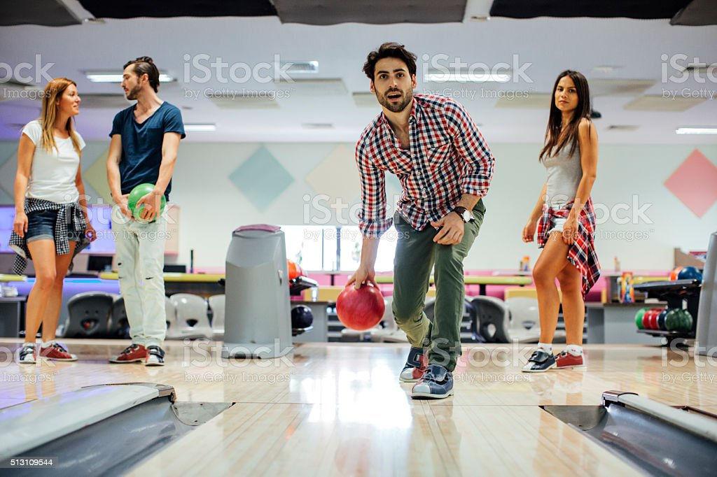 Young Man bowling with his friends.. stock photo