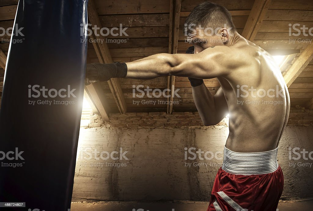 Young man boxing, exercise in the attic stock photo