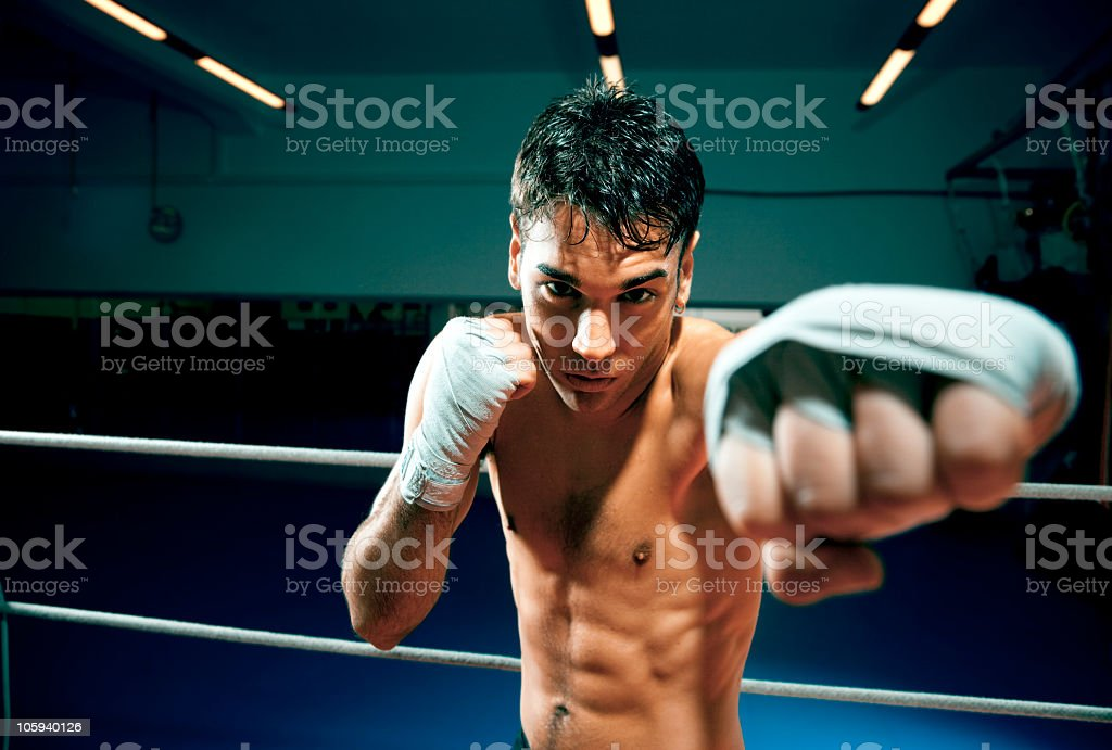 A young man boxing in a boxing ring royalty-free stock photo