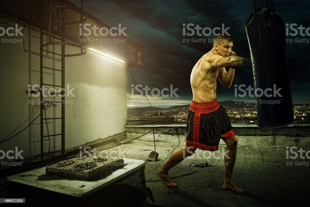 Young man boxing training , on top of the house stock photo