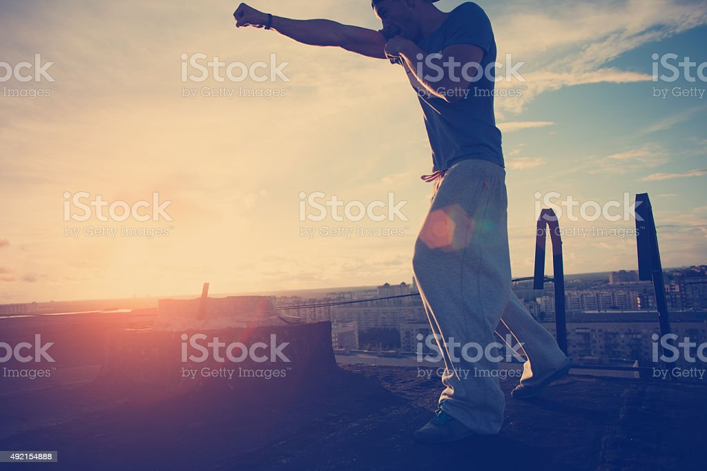 Young man boxing with shadow stock photo