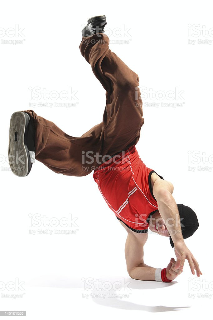 Young man break dancing on his elbows on white background royalty-free stock photo