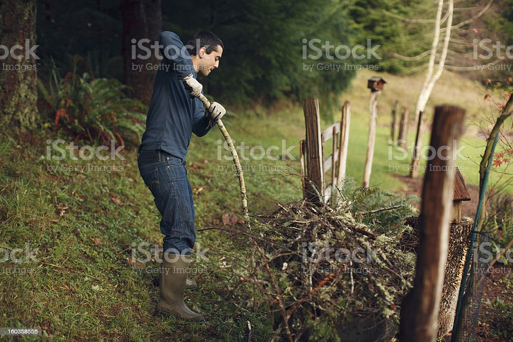 Young Man Breaking a Stick stock photo