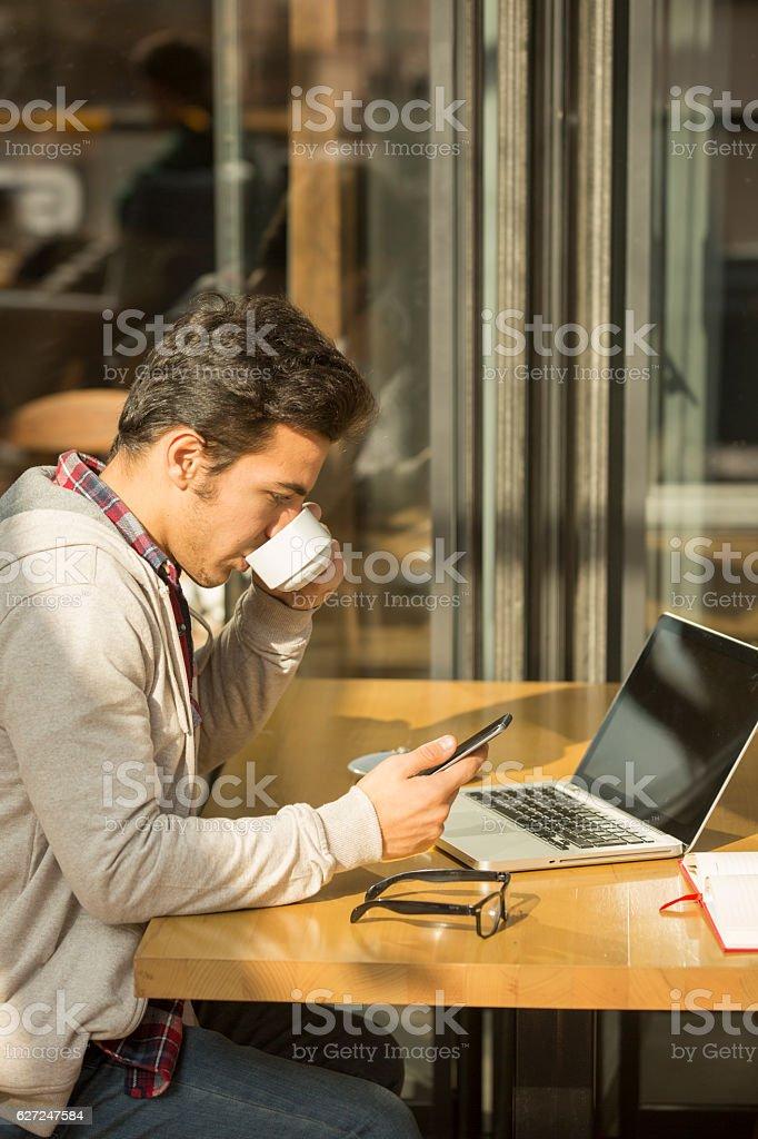 Young Man Browsing Social Media stock photo