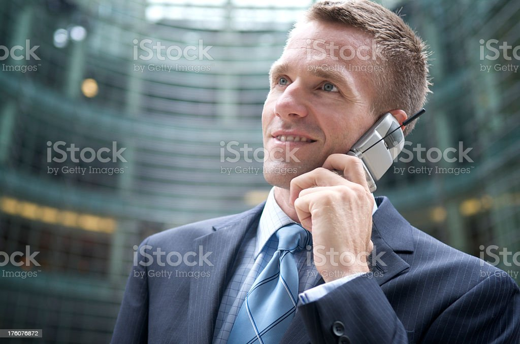 Young Man Businessman Talking Mobile Flip Phone Office Background stock photo
