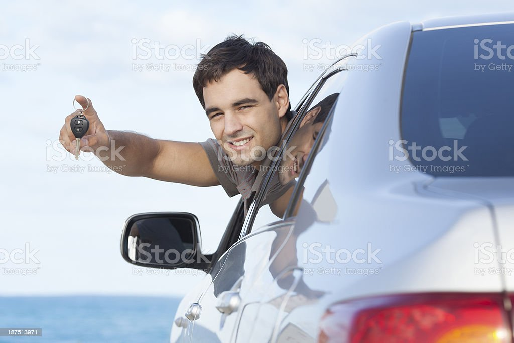 Young man buying a new car. stock photo