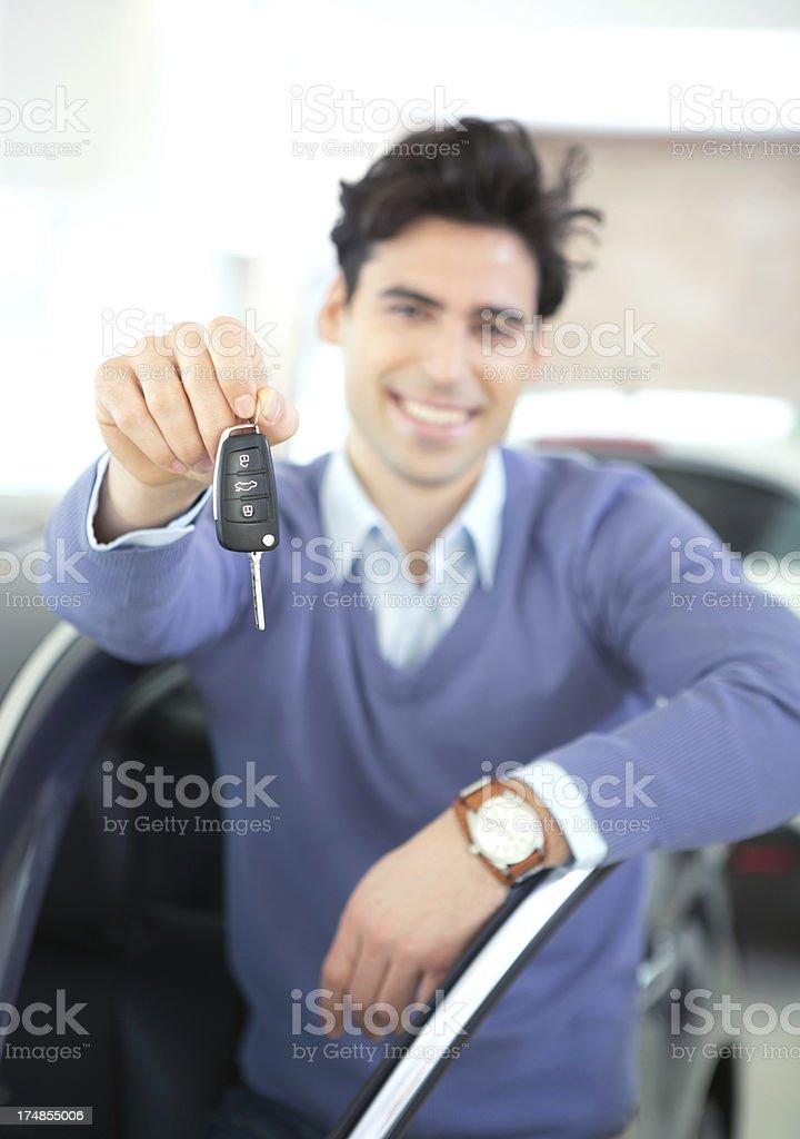 Young man buying car. royalty-free stock photo