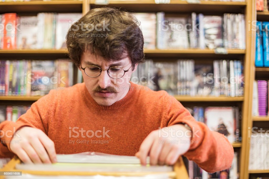 Young Man Buying Record Albums stock photo