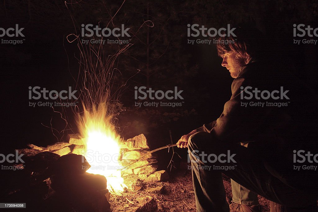 Young Man by the Campfire royalty-free stock photo