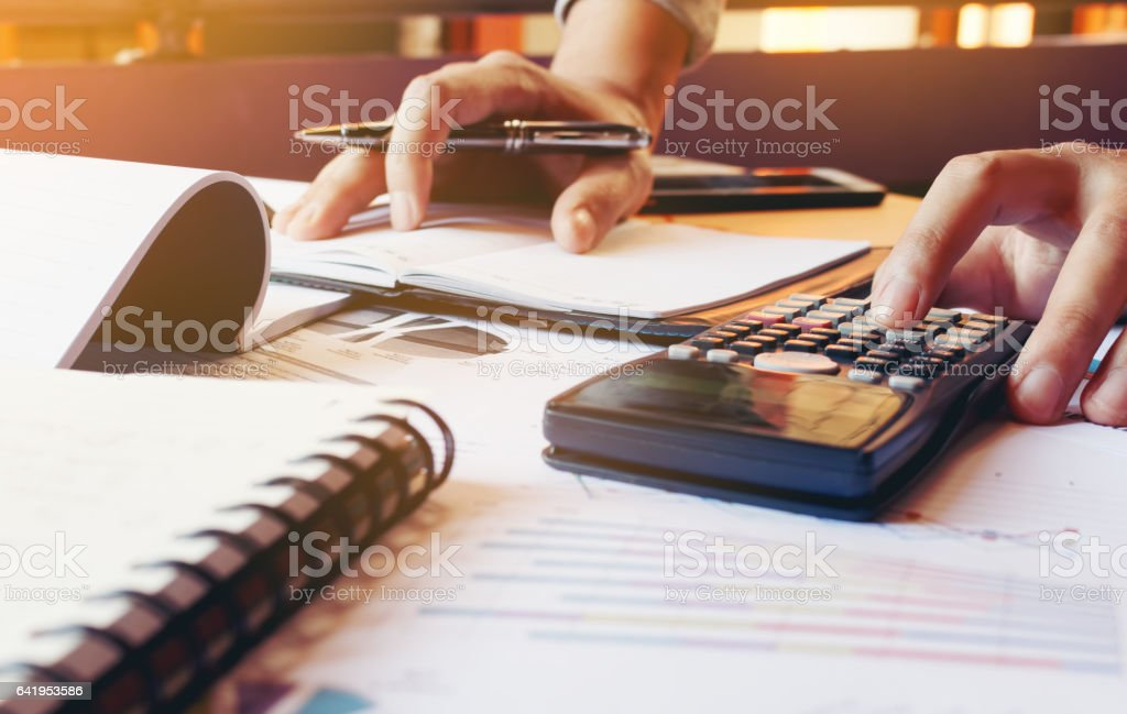 Young man calculate finance about expenses in home office. stock photo