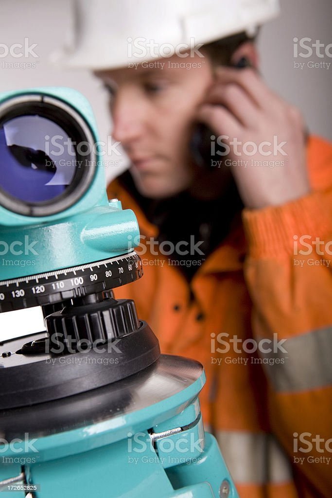 Young man calling in case of land measurement royalty-free stock photo
