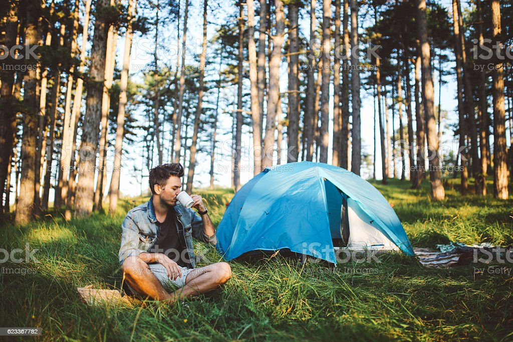 Young man camping stock photo