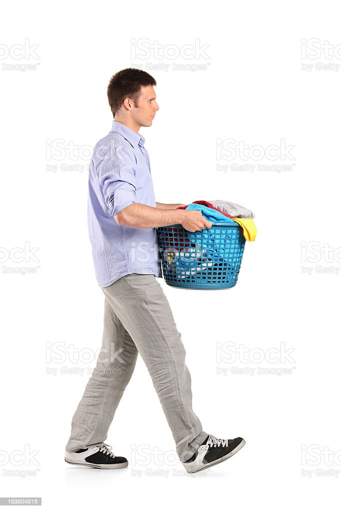 Young man carrying a laundry basket royalty-free stock photo
