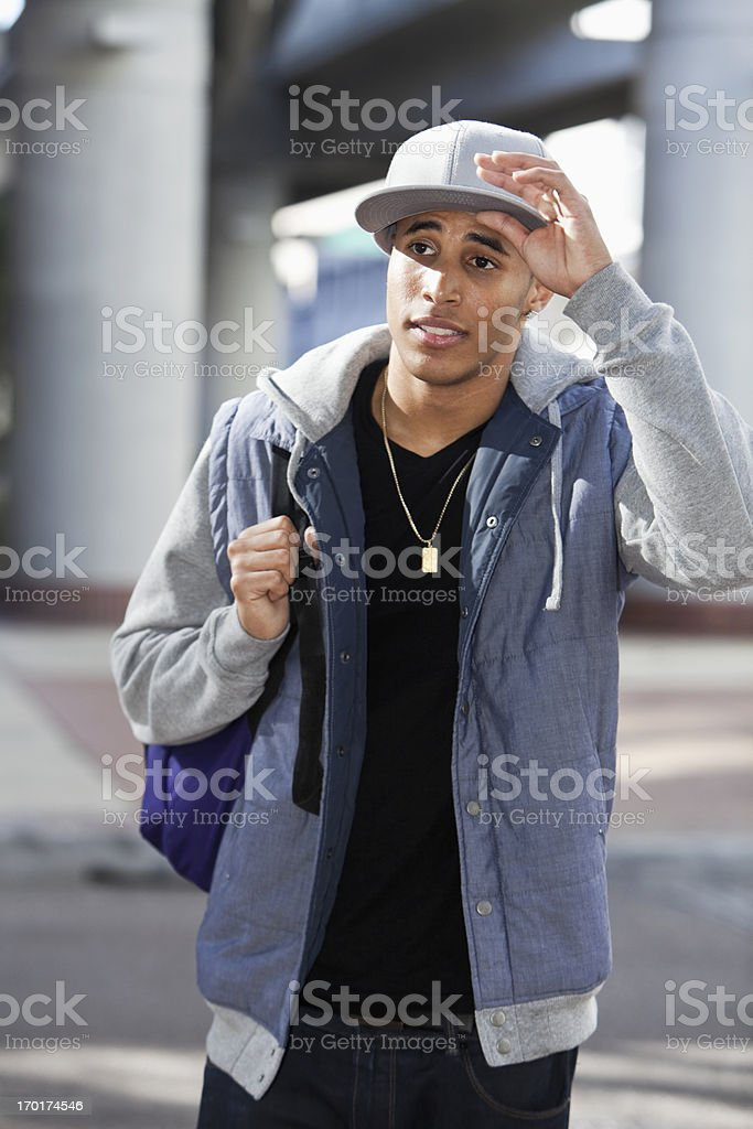 Young man carrying backpack stock photo