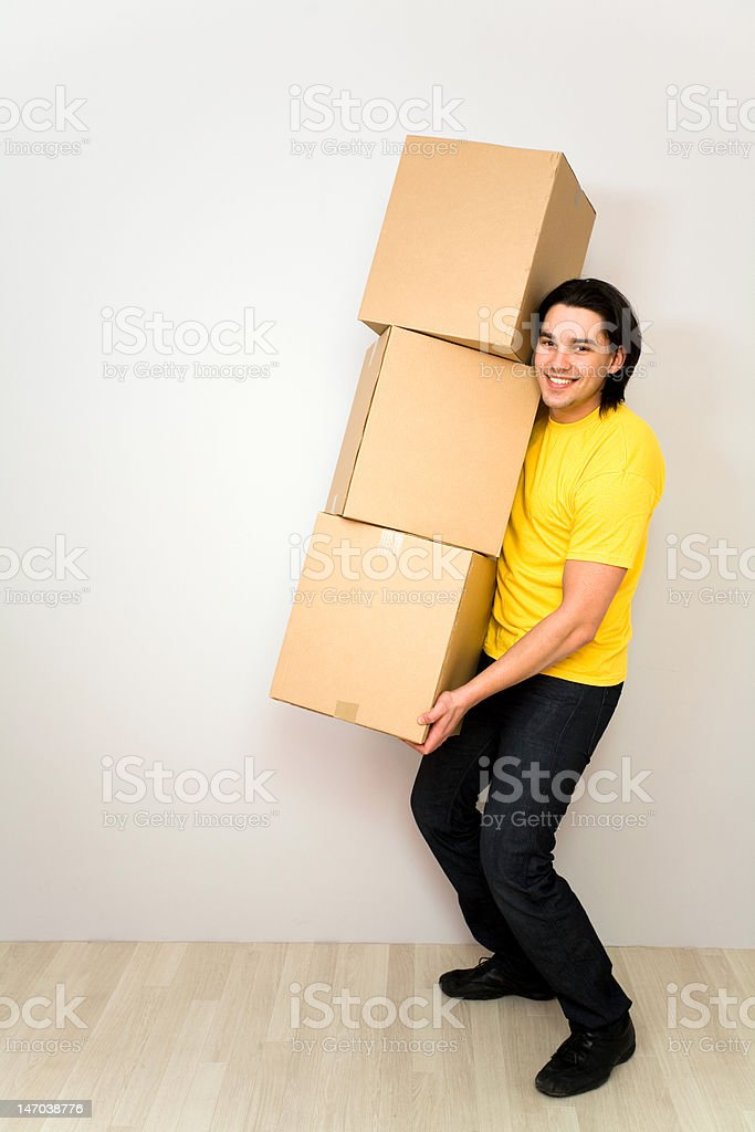 Young man carrying boxes royalty-free stock photo
