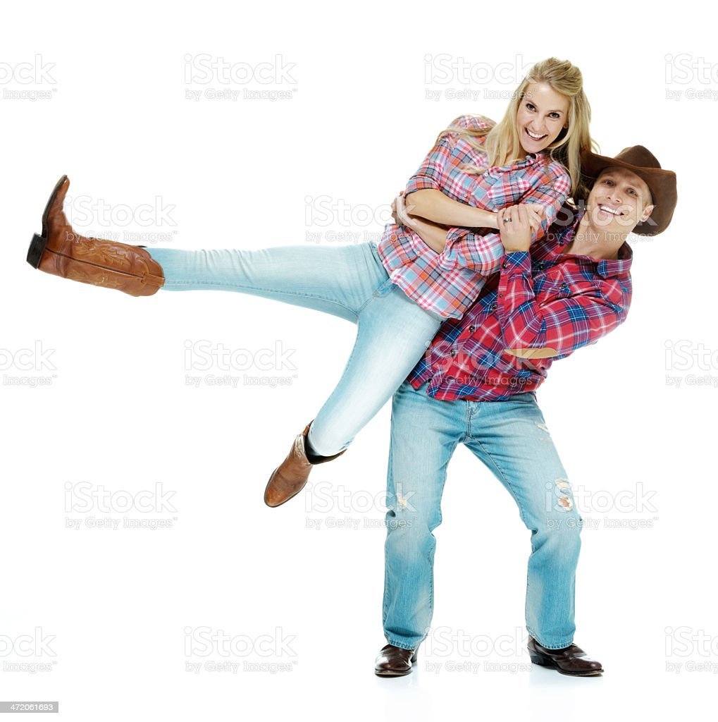 Young man carrying his girl friend stock photo