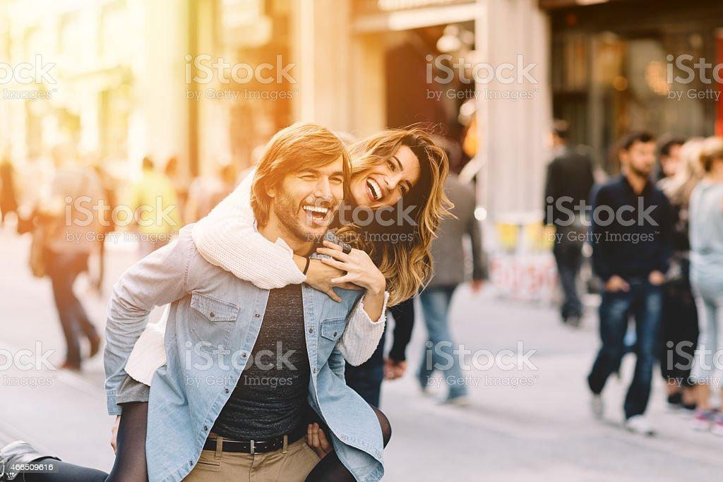 Young man carrying his girlfriend at piggyback stock photo