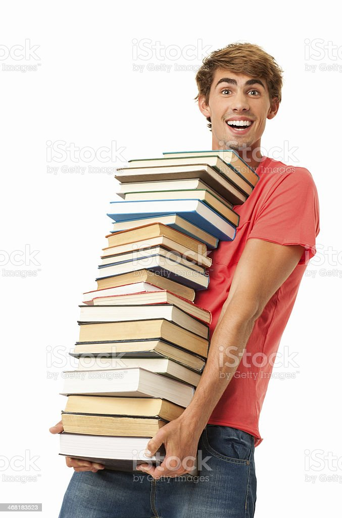 Young Man Carrying Stack Of Books - Isolated stock photo