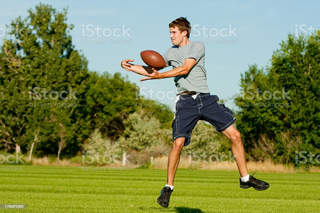Young Man Catching Football royalty-free stock photo