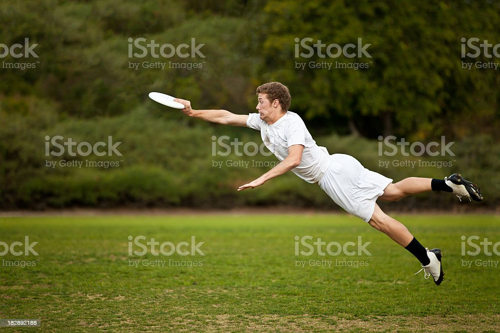 Young Man Catching Frisbee stock photo