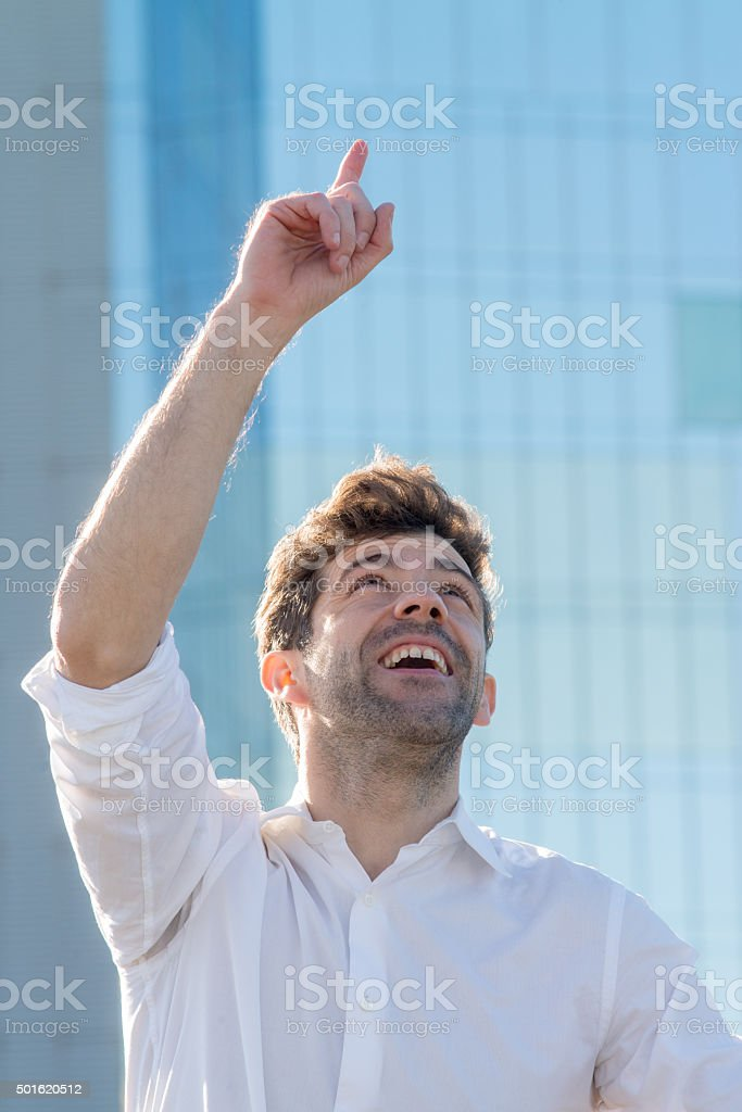 Young man celebrate winning his finger up stock photo
