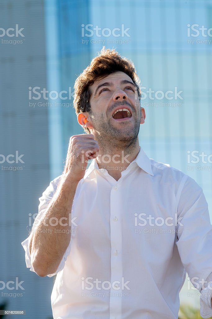 young man celebrates victory with his fist stock photo