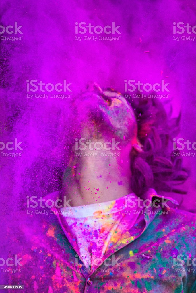 Young Man Celebrating Holi Festival in India stock photo