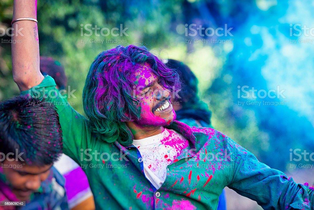 Young Man Celebrating Holi Festival in India stock photo