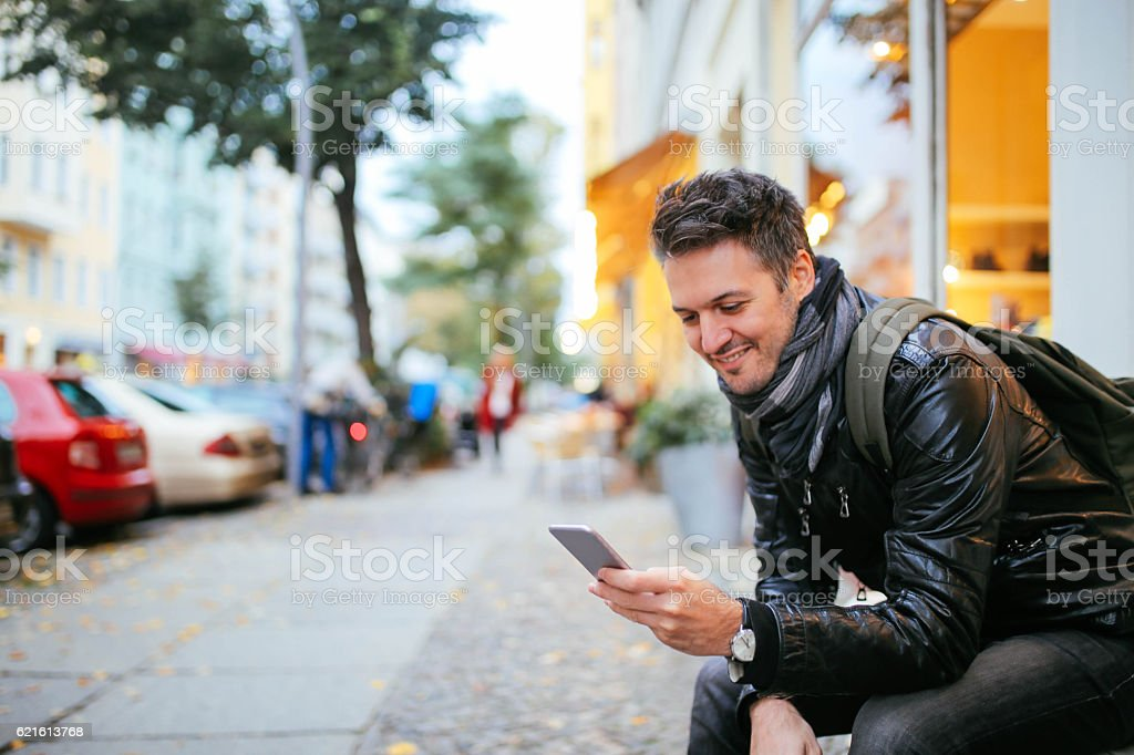 Young man checking cellphone in Berlin Germany stock photo