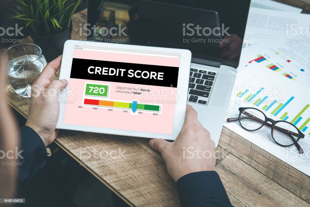 Young man checking Credit Score on Tablet Pc stock photo