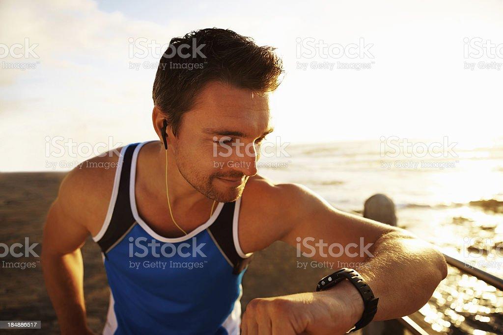 Young man checking his pulse royalty-free stock photo