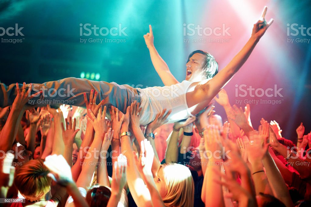 Riding a wave of fans stock photo