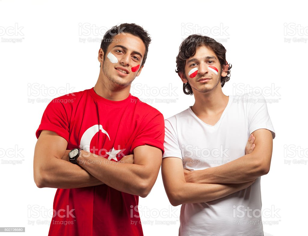Young man cheering on white background stock photo