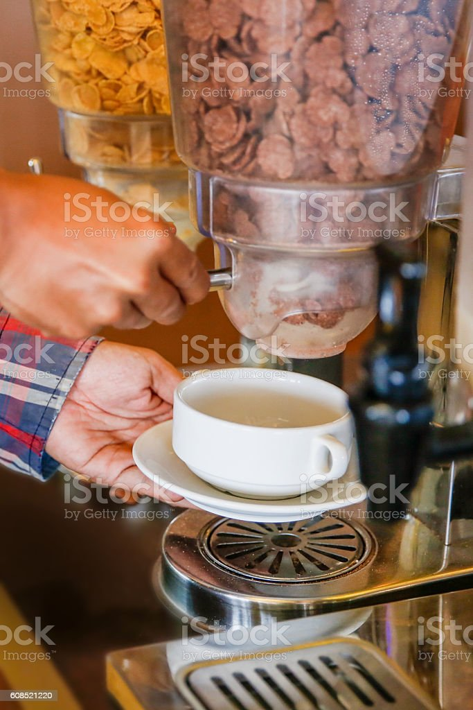 Young man choosing breakfast cereal stock photo