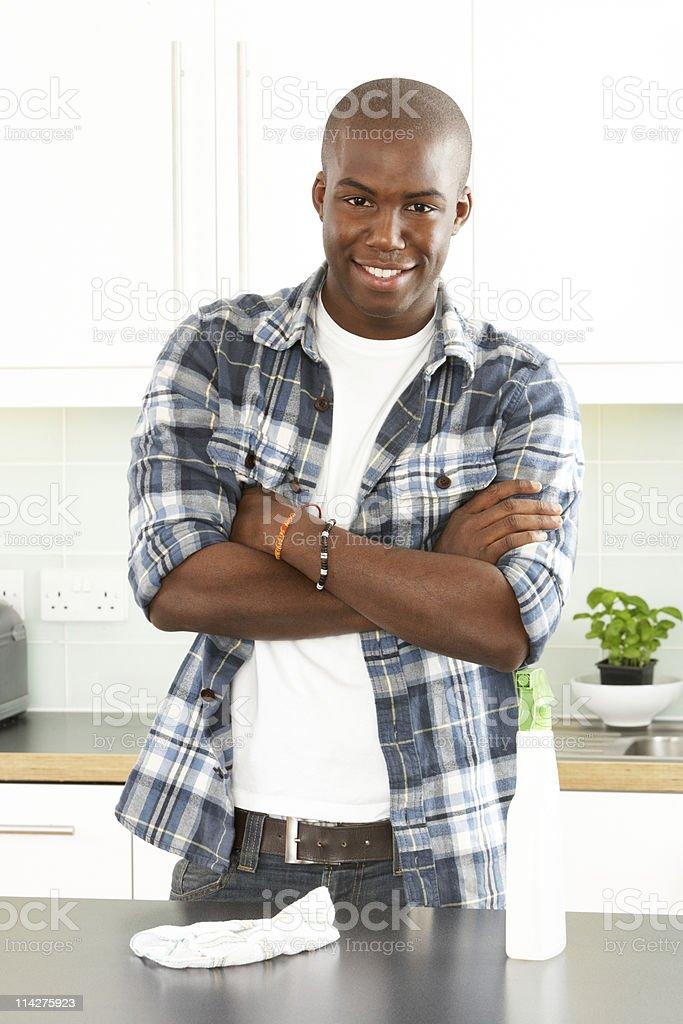 Young Man Cleaning Kitchen stock photo