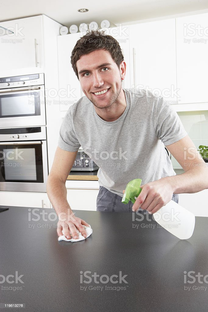 Young Man Cleaning Modern Kitchen stock photo