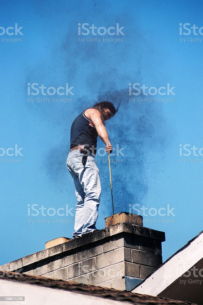 Young man cleaning the chimney stock photo