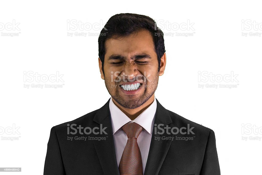 Young Man Clenches Teeth stock photo