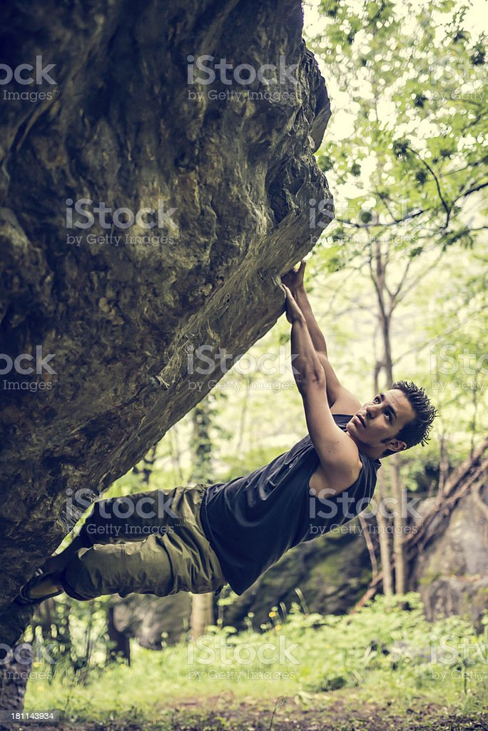 Young Man Climb Boulder royalty-free stock photo