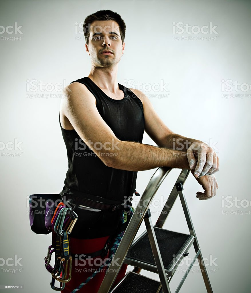Young Man Climbing ladder royalty-free stock photo