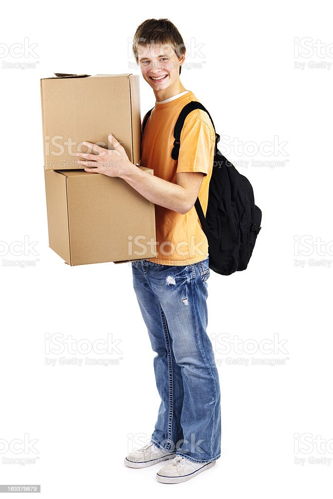 Young Man College Student Moving into Dormitory with Cardboard Boxes royalty-free stock photo