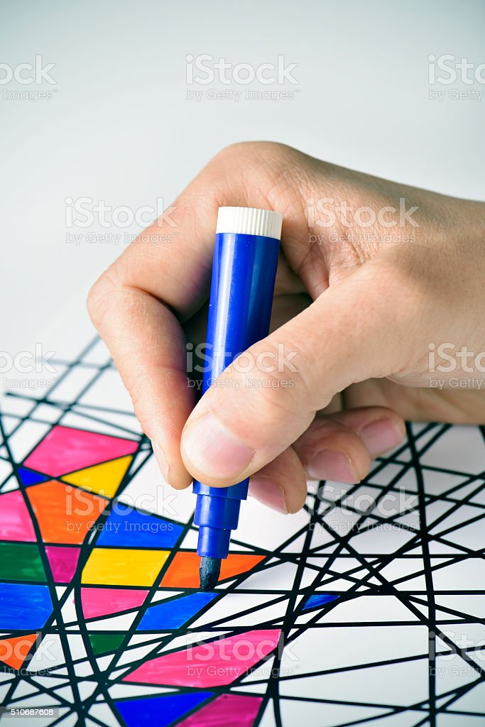 young man coloring a drawing, designed by myself stock photo