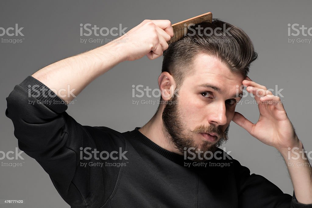 young man comb his hair stock photo