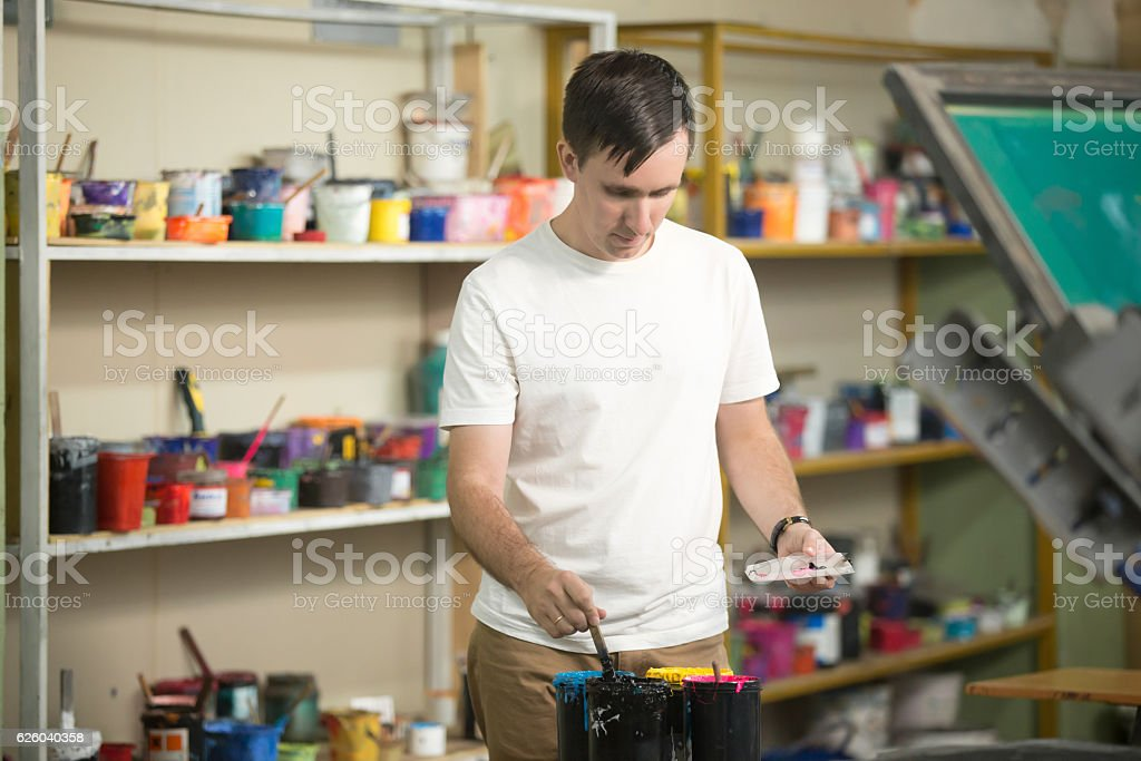 Young man combining CMYK stock photo