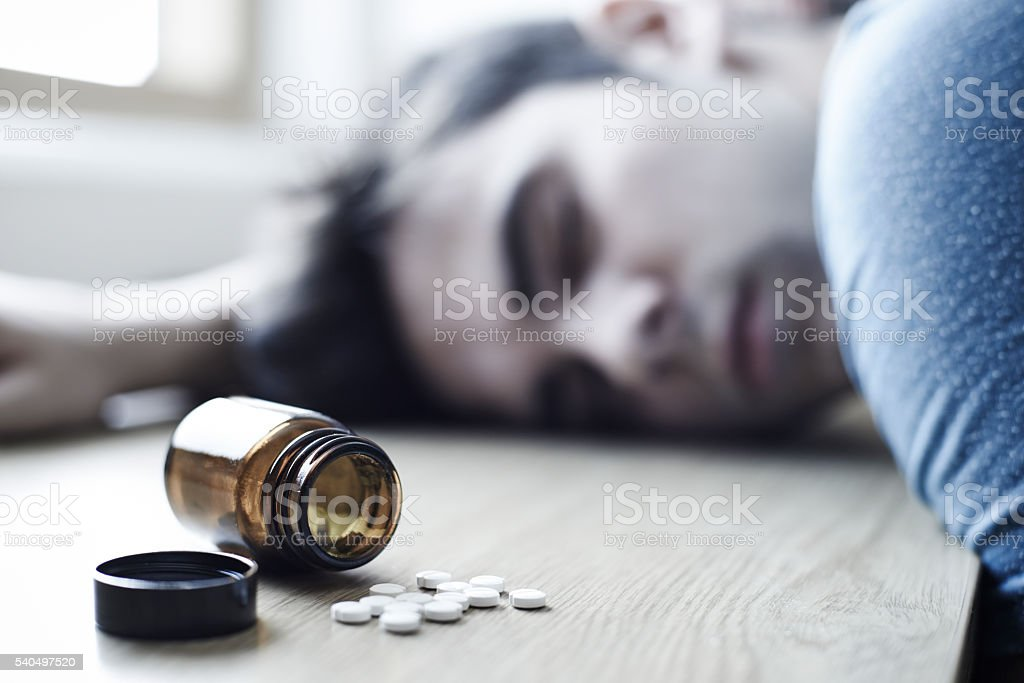 Young Man Commiting Suicide By Overdosing On Medication stock photo