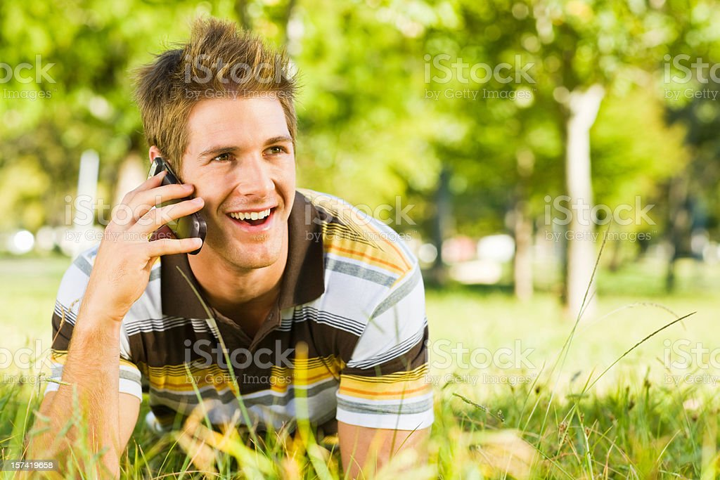 Young man communicating on cellphone royalty-free stock photo