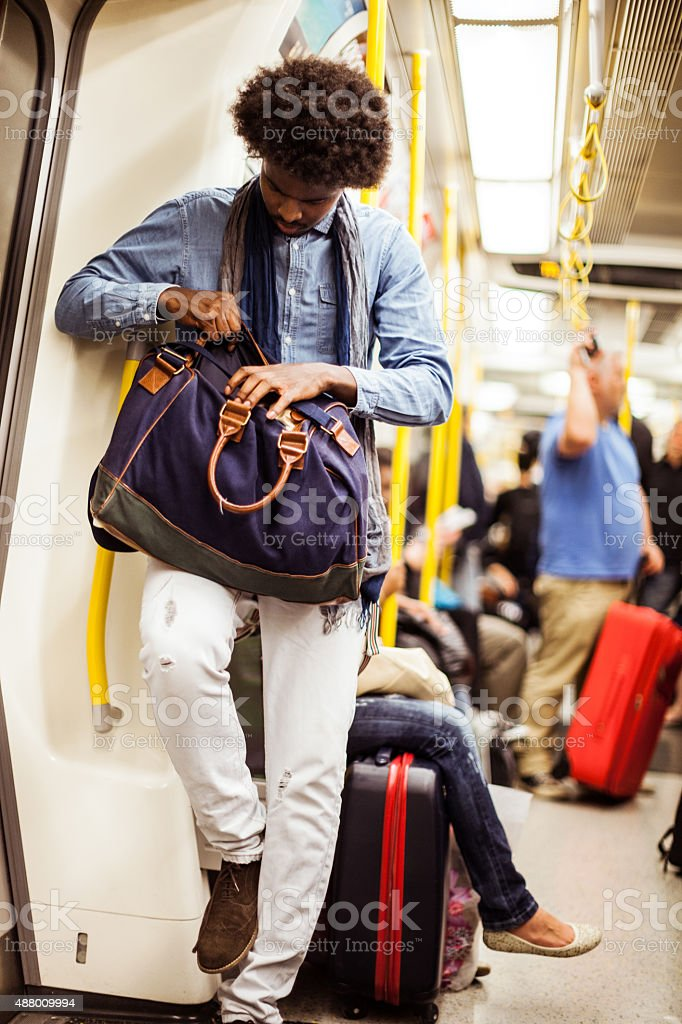 Young man commuting in subway train stock photo